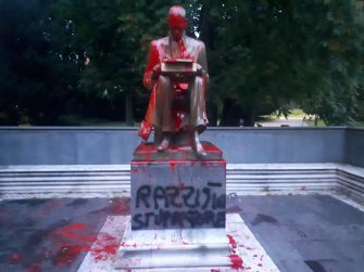 "The statue dedicated to Indro Montanelli has been smeared with red paint, located in the homonymous garden in via Palestro, in the center of Milan, Italy, 13 June 2020. ""Racist, rapist"" the writing that was made in black on the basis of the statue that represents the journalist. ANSA/STRINGER"