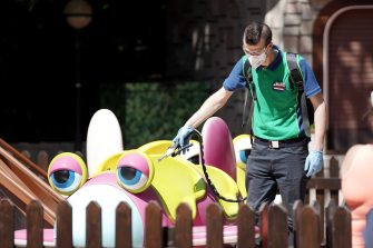CASTELNUOVO DEL GARDA, ITALY - JUNE 13: A member of the staff sanitizes one of the attraction for children at the Gardaland Amusement Theme Park opening on June 13, 2020 in Castelnuovo del Garda, Italy. Gardaland Amusement Theme Park is the first one to reopen in Italy after the ease of the lockdown imposed for the Covid-19 pandemic. (Photo by Vittorio Zunino Celotto/Getty Images)