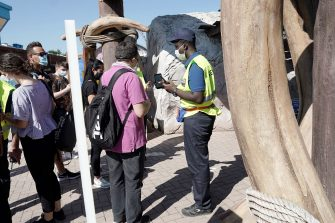 CASTELNUOVO DEL GARDA, ITALY - JUNE 13: A member of the staff gives informations to visitors at the Gardaland Amusement Theme Park opening on June 13, 2020 in Castelnuovo del Garda, Italy. Gardaland Amusement Theme Park is the first one to reopen in Italy after the ease of the lockdown imposed for the Covid-19 pandemic. (Photo by Vittorio Zunino Celotto/Getty Images)