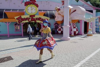 CASTELNUOVO DEL GARDA, ITALY - JUNE 13: A performer greets the photographer at the Gardaland Amusement Theme Park opening on June 13, 2020 in Castelnuovo del Garda, Italy. Gardaland Amusement Theme Park is the first one to reopen in Italy after the ease of the lockdown imposed for the Covid-19 pandemic. (Photo by Vittorio Zunino Celotto/Getty Images)