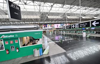 A general view shows Alitalia check-in counters in a deserted Terminal T1 at Rome's Fiumicino international airport on March 17, 2020. - Rome's second airport, Ciampino, has been closed, while Fiumicino is to close the T1, one of its three terminals from March 17. (Photo by ANDREAS SOLARO / AFP) (Photo by ANDREAS SOLARO/AFP via Getty Images)