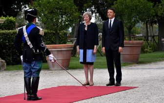 Italian Prime Minister Matteo Renzi and his British counterpart Theresa May stand during a welcome ceremony for Britain's Prime Minister in the garden of Villa Doria Pamphili prior to a meeting in Rome on July 27, 2016. / AFP / TIZIANA FABI        (Photo credit should read TIZIANA FABI/AFP via Getty Images)