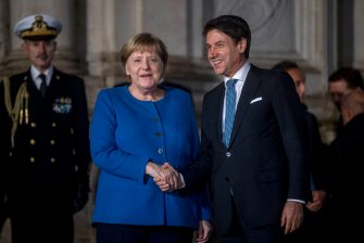 ROME, ITALY - NOVEMBER 11: Italian Prime Minister Giuseppe Conte (R) and German Chancellor Angela Merkel shake hands before a joint press conference at Villa Pamphili, on November 11, 2019 in Rome, Italy. Italian Premier Giuseppe Conte and German Chancellor Angela Merkel met to discuss the crisis in Libya and the migrant situation during a dinner at Rome's Villa Doria Pamphili. (Photo by Antonio Masiello/Getty Images)