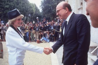 Prime Minister of Italy Bettino Craxi shakes the hand of Princess Diana during a welcome party for the royalty in Villa Doria Pamphili, Rome 1985. (Photo by Archivio Cicconi/Getty Images)