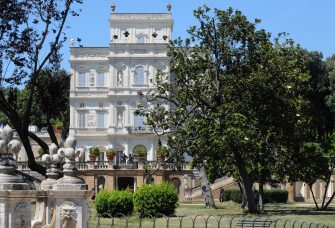 This picture taken on June 11, 2009 shows policemen guarding the 17th-century palace Villa Doria Pamphili in Rome which host the Libyan leader Moamer Kadhafi during his first visit to Italy. The Libyan leader has also pitched his trademark tent in the park . AFP PHOTO / TIZIANA FABI (Photo credit should read TIZIANA FABI/AFP via Getty Images)