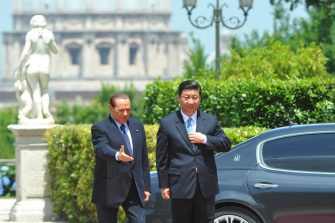 Italy's Prime Minister Silvio Berlusconi (L) greets Chinese Vice President Xi prior a meeting on June 3, 2011 at Villa Pamphili in Rome. World leaders the day before gathered for celebrations to mark the founding of the Italian republic in 1946 and the 150th anniversary of Italian unification.  AFP PHOTO / ANDREAS SOLARO (Photo credit should read ANDREAS SOLARO/AFP via Getty Images)