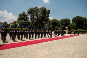 Italian Prime Minister Matteo Renzi (2nd-R) and his Canadian counterpart Stephen Harper review an honour guard before their meeting at Villa Pamphili in Rome on June 11, 2015 . AFP PHOTO / ANDREAS SOLARO        (Photo credit should read ANDREAS SOLARO/AFP via Getty Images)
