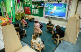Nursery children sit apart from each other to minimise the risk of passing on Coronavirus at Willowpark Primary Academy in Oldham, north-west England on June 18, 2020, as primary schools to recommence education for Reception, Years 1 and Year 6 classes, alongside priority groups. (Photo by OLI SCARFF / AFP) (Photo by OLI SCARFF/AFP via Getty Images)