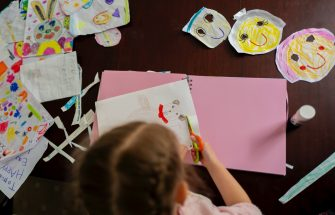 MANCHESTER, ENGLAND - JUNE 03: The photographer's daughter Charlotte Rose, 5, makes a scrap book as home schooling continues in regions where schools don't reopen until next week on June 03, 2020 in Manchester, United Kingdom. The British government further relaxed Covid-19 quarantine measures in England this week, allowing groups of six people from different households to meet in parks and gardens, subject to social distancing rules. Many schools also reopened and vulnerable people who are shielding in their homes are allowed to go outside again. (Photo by Anthony Devlin/Getty Images)