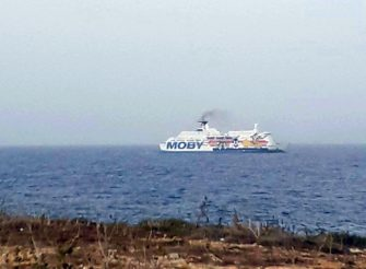 A handout photo made available by the Moby Press Office shows the ship 'Moby Zaza', the quarantine ship prepared by the Italian Government, on the Agrigentian coast to deal with the immigration emergency and Covid-19, upon its arrival in Lampedusa, near Agrigento, 17 May 2020. The boat will load the 68 migrants, including 26 women and 2 children, who landed yesterday in Cala Madonna and then is expected to return to Porto Empedocle where it is expected to remain for the entire quarantine period. AANS/Moby Press Office / HANDOUT  HANDOUT EDITORIAL USE ONLY/NO SALES