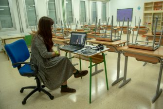 """IRUN, SPAIN - MAY 25: A teacher teaches online classes in an empty classroom at Eguzkitza Secondary School on May 25, 2020 in Irun, Spain. Some parts of Spain have entered the so-called """"Phase One"""" or """"Phase Two"""" transitions from its coronavirus lockdown, allowing many shops to reopen as well as restaurants who serve customers outdoors. Locations that were harder hit by coronavirus (Covid-19), such as Madrid and Barcelona, remain in a stricter quarantine. (Photo by Gari Garaialde/Getty Images)"""