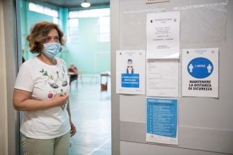 TURIN, ITALY - JUNE 17: A teacher wears a protective mask awaits students for High School Graduation Exams inside the Colombatto State Professional Institute on June 17, 2020 in Turin, Italy. High School Graduation Exams starting today with a change in the traditional process as Covid-19 pandemic forced the teachers to have an oral examination. (Photo by Stefano Guidi/Getty Images)
