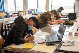 """IRUN, SPAIN - MAY 25: Students wearing face masks work during a technology subject class at the BIDASOA Vocational School on May 25, 2020 in Irun, Spain. Some parts of Spain have entered the so-called """"Phase One"""" or """"Phase Two"""" transitions from its coronavirus lockdown, allowing many shops to reopen as well as restaurants who serve customers outdoors. Locations that were harder hit by coronavirus (Covid-19), such as Madrid and Barcelona, remain in a stricter quarantine. (Photo by Gari Garaialde/Getty Images)"""