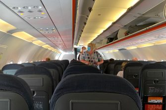 Passengers board an Easyjet domestic flight at an airport in the United Kingdom on June 15, 2020 as the low cost carrier resumes flights for the first time since the March coronavirus lockdown. (Photo by - / AFP) (Photo by -/AFP via Getty Images)