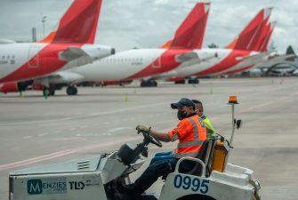 "Workers drive a trolley past planes of Avianca airlines on the tarmac at El Dorado International Airport on June 25, 2020 during the COVID-19 coronavirus pandemic. - Avianca, the second-largest airline in Latin America, filed for bankruptcy protection in the United States on May 10, 2020 to reorganize its debt ""due to the unpredictable impact"" of the coronavirus pandemic. (Photo by Juan BARRETO / AFP) (Photo by JUAN BARRETO/AFP via Getty Images)"