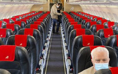 MILAN, ITALY - JUNE 03:  A man sitting alone inside an empty airplane due to restrictions from COVID-19 on June 03, 2020 in Milan, Italy. Flights have started again from the ease of the Covid-19 lockdown on June 3rd.  (Photo by Lorenzo Palizzolo/Getty Images)