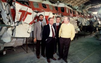 ROME, ITALY - OCTOBER 30: In a hangar of the military airport of Pratica di Mare (Rome) the magistrate Rosario Priore (2nd-L) poses during a judicial inquiry in front the reassembled of Itavia plane flight 870 which crashed on June 27th, 1980 on October 30, 1992 in Rome, Italy. On June 27th, 1980 the Itavia flight 870 which crashed between the islands of Ponza and Ustica killing all 81 people on board. This event led to many investigations, accusations and misdirections, and continues to be a source of controversy in the country. (Photo by Franco Origlia/Getty Images)