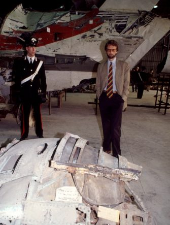 ROME, ITALY - OCTOBER 30: In a hangar of the military airport of Pratica di Mare (Rome) the Civil attorney poses during a judicial inquiry in front the reassembled of Itavia plane flight 870 which crashed on June 27th, 1980 on October 30, 1992 in Rome, Italy. On June 27th, 1980 the Itavia flight 870 which crashed between the islands of Ponza and Ustica killing all 81 people on board. This event led to many investigations, accusations and misdirections, and continues to be a source of controversy in the country. (Photo by Franco Origlia/Getty Images)