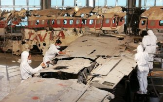 This handout photo shows the boys of the course of Restoration of the Academy of Fine Arts of Bologna at work during the maintenance of the wreck of the Dc9 of Ustica, housed in the Museum for the Memory of the massacre in Bologna, 09 October 2019. The second tranche of the operation, which involved cleaning up the plane's pieces from the dust and degradation that have accumulated in recent years, the safety of tags and labels describing each individual part and a mapping monitoring the retention status of the entire device.  ANSA / us Istituzione Bologna Musei   +++  ANSA PROVIDES ACCESS TO THIS HANDOUT PHOTO TO BE USED SOLELY TO ILLUSTRATE NEWS REPORTING OR COMMENTARY ON THE FACTS OR EVENTS DEPICTED IN THIS IMAGE; NO ARCHIVING; NO LICENSING  +++