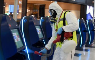 An operator disinfects self-service check-in kiosks at Orly 3 terminal's departure hall on the day of the re-opening of Paris' Orly airport on June 26, 2020. (Photo by ERIC PIERMONT / AFP) (Photo by ERIC PIERMONT/AFP via Getty Images)