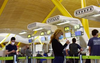 MADRID, SPAIN - JUNE 21: People check in at the Adolfo Suarez Madrid Barajas airport on June 21, 2020 in Madrid, Spain. From today Spanish citizens can move around the country after almost one hundred days of alarm state because of the coronavirus crisis. (Photo by Ely Pineiro/Getty Images)