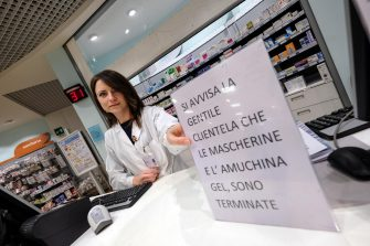 An employee shows a sign informing customers that the Amuchina disinfectant and protective face masks are sold out, Palermo, Italy, 25 February 2020.  ANSA / Igor Petyx