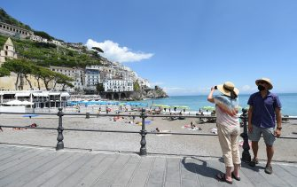 AMALFI, ITALY - JUNE 06: A couple of tourists taking pictures at Amalfi's port on June 06, 2020 in Amalfi, Italy. Many Italian businesses have been allowed to reopen, after more than two months of a nationwide lockdown meant to curb the spread of Covid-19. (Photo by Francesco Pecoraro/Getty Images)