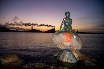 """The lettering """"Free Hong Kong"""" is written on the base of the Little Mermaid statue in Copenhagen after it has been exposed to vandalism early Monday, January 13, 2020. (Photo by Thomas Sjoerup / Ritzau Scanpix / AFP) / Denmark OUT (Photo by THOMAS SJOERUP/Ritzau Scanpix/AFP via Getty Images)"""