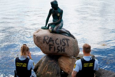 TOPSHOT - Danish police officers take pictures of the base of the Little Mermaid statue (Den lille Havfrue) after it was vandalised on July 3, 2020. (Photo by Mads Claus Rasmussen / Ritzau Scanpix / AFP) / Denmark OUT (Photo by MADS CLAUS RASMUSSEN/Ritzau Scanpix/AFP via Getty Images)
