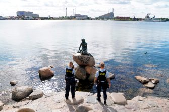 Danish police officers take pictures of the base of the Little Mermaid statue (Den lille Havfrue) after it was vandalised on July 3, 2020. (Photo by Mads Claus Rasmussen / Ritzau Scanpix / AFP) / Denmark OUT (Photo by MADS CLAUS RASMUSSEN/Ritzau Scanpix/AFP via Getty Images)