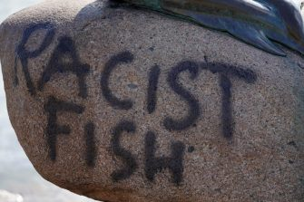 """A picture taken on July 3, 2020 shows a graffiti on the rock below the """"Little Mermaid"""" sculpture after it has been vandalised in Copenhagen. (Photo by Mads Claus Rasmussen / Ritzau Scanpix / AFP) / Denmark OUT (Photo by MADS CLAUS RASMUSSEN/Ritzau Scanpix/AFP via Getty Images)"""