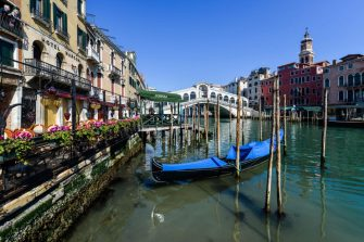 A view shows clear waters by a gondola outside Hotel Marconi (L) in Venice's Grand Canal near the Rialto Bridge (Rear) on March 18, 2020 as a result of the stoppage of motorboat traffic, following the country's lockdown within the new coronavirus crisis. (Photo by ANDREA PATTARO / AFP) (Photo by ANDREA PATTARO/AFP via Getty Images)