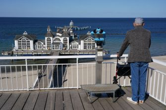 SELLIN, GERMANY - MAY 14: An elderly man looks out at Sellin Pier and beach on Ruegen Island during the coronavirus crisis on May 14, 2020 in Sellin, Germany. Mecklenburg-Western Pomerania, the state in which Ruegen Island is located, has been easing lockdown measures over recent weeks and is planning to allow visitors from outside the state borders in starting May 25. Mecklenburg-Western Pomerania's Baltic Sea resorts are especially dependent on tourism and have been hit financially hard by the lockdown measures. (Photo by Sean Gallup/Getty Images)