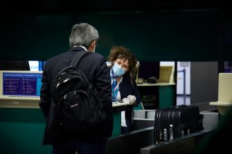 MILAN, ITALY - JUNE 03:  A man checks in at Milan Malpensa airport on the first day of reopening after the lockdown on June 03, 2020 in Milan, Italy. Flights have started again from the ease of the Covid-19 lockdown on June 3rd.  (Photo by Lorenzo Palizzolo/Getty Images)