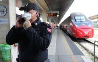 """VENICE, ITALY - MARCH 9: Policemen check citizens and tourists at the Venice Santa Lucia railway station, to make sure that they are not violating the quarantine, before they get on the trains to leave the city on March 9, 2020 in Venice, Italy. Prime Minister Giuseppe Conte announced a """"national emergency"""" due to the coronavirus outbreak and imposed quarantines on the Lombardy and Veneto regions, which contain roughly a quarter of the country's population. Italy has the highest number of cases and fatalities in Europe.  The movements in and out are allowed only for work reasons, health reasons proven by a medical certificate.The justifications for the movements needs to be certified with a self-declaration by filling in forms provided by the police forces in charge of the checks. (Photo by Marco Di Lauro/Getty Images)"""