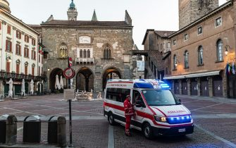 BERGAMO, ITALY - APRIL 8: An ambulance of the Italian Red Cross is seen in one of the main squares of the city on April 8, 2020 in Bergamo, Italy.  The number of new COVID-19 cases appears to be decreasing in Italy, including in the province of Bergamo, one of its hardest-hit areas. But as the infection rate slows, life is still far from normal. Roughly 4,800 people have died in Bergamo, nearly one-third of the country's total death toll, and everyone here knows someone affected: a neighbor, a family member, a relative, a friend or an acquaintance. The Italian Red Cross, which runs an ambulance service here, continues to field constant calls for help. With only a small portion of its 600-person volunteer crew and 38 paid staff able to report for duty, those who remain work shifts of up to 20 hours long. (Photo by Marco Di Lauro/Getty Images)