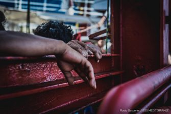 epa08527228 A handout photo made available by the press office of SOS Mediterranee, shows migrants boarded on Ocean Viking ship at the Mediterranean Sea, 04 July 2020. The ship is in international waters of Mediterranean Sea with 180 rescued migrants on board.  SOS Mediterranee for days asks to be able to disembark the migrants after declaring state of emergency due to the precarious conditions of the rescued people.  EPA/FLAVIO GASPERINI / SOS MEDITERRANEE / HANDOUT  HANDOUT EDITORIAL USE ONLY/NO SALES