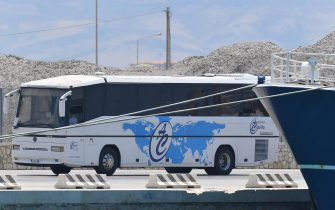 A bus with migrants landed in Porto Empedocle from the Moby Zaz‡ ferry after the quarantine period. The ferry awaiting the transhipment of 180 other migrants from the humanitarian vessel Ocean Viking, Porto Empedocle (Agrigento), Sicily, 6 July 2020. ANSA / CARMELO IMBESI