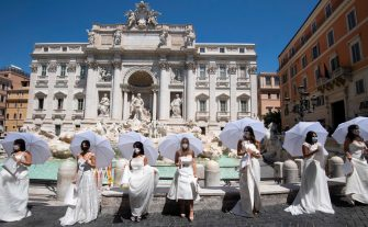 A moment of the flash mob protest of brides in Trevi's fountain for the forced postponement of their marriages due to the covid19 coronavirus, Rome, 7 Jule 2020. ANSA/CLAUDIO PERI