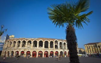 VERONA, ITALY - JULY 14: (EDITORS NOTE: Exposure latitude of this composite image has been digitally increased) Piazza Bra and the Arena of Verona with a palm tree on July 14, 2010 in Verona, Italy. The famous Arena di Verona is popular for the annual opera festival in summer. The arena is one of the largest ancient roman amphitheatres. It was built in 30 A.C. and belongs to the Unesco World Heritage.  (Photo by EyesWideOpen/Getty Images)