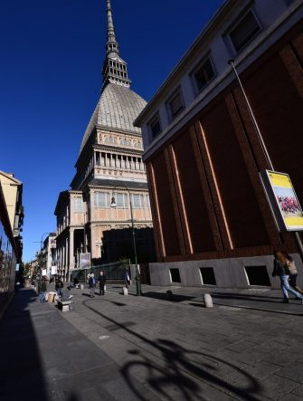 This picture taken on November 11, 2013 in Turin shows the shadow of a bicycle hung at a street lamp near the Mole Antonelliana, built in the nineteenth century by Italian architect Alessandro Antonelli and currently hosting the National Cinema Museum.   AFP PHOTO / GIUSEPPE CACACE        (Photo credit should read GIUSEPPE CACACE/AFP via Getty Images)