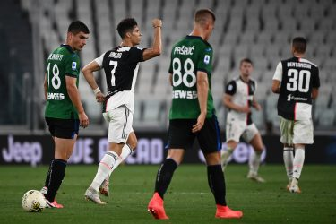 Juventus' Portuguese forward Cristiano Ronaldo (C) celebrates after scoring his second penalty during the Italian Serie A football match Juventus Turin vs Atalanta Bergamo played behind closed doors on July 11, 2020 at the Juventus stadium in Turin, as the country eases its lockdown aimed at curbing the spread of the COVID-19 infection, caused by the novel coronavirus. (Photo by Marco BERTORELLO / AFP) (Photo by MARCO BERTORELLO/AFP via Getty Images)