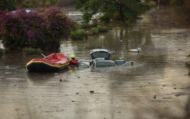 PALERMO, ITALY - JULY 15: Firefighters perform search and rescue after a storm flooded part of the town on July 15, 2020 in Palermo, Italy. After a storm, the city was in complete panic with the meteo station registering more than 80 mm of rain within few minutes.  (Photo by Tullio Puglia/Getty Images)