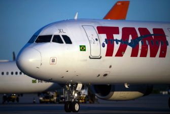 An aircraft of Brazilian airline TAM is parked at Galeao International Airport in Rio de Janeiro, Brazil, on May 27, 2018. (Photo by MAURO PIMENTEL / AFP)        (Photo credit should read MAURO PIMENTEL/AFP via Getty Images)