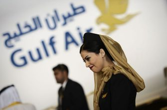 A Gulf Air hostess smiles during the opening of the Bahrain International Airshow 2016, in Sakhir, south of the capital Manama, on January 21, 2016.  / AFP / MOHAMMED AL-SHAIKH        (Photo credit should read MOHAMMED AL-SHAIKH/AFP via Getty Images)