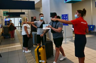 ZAKYNTHOS, GREECE - JULY 15: Passengers of a flight from United Kingdom wearing protective face masks arrive at the Zakinthos Airport on Zakinthos Island on July 15, 2020 in Zakynthos, Greece. (Photo by Milos Bicanski/Getty Images)
