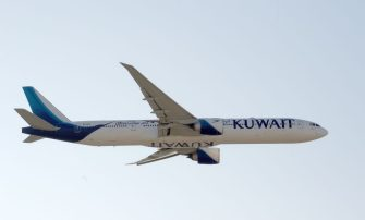 A Kuwait Airways Boeing B777 aircraft performs air maneuvers during the 2018 Bahrain International Airshow (BIAS) at the Sakhir Airbase, south of the Bahraini capital Manama on November 14 2018. (Photo by STR / AFP)        (Photo credit should read STR/AFP via Getty Images)