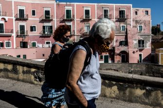 VENTOTENE, ITALY - JULY 14: Tourists walk past the Ancient Roman Port Area on July 14, 2020 in Ventotene, Italy. The tiny Island of Ventotene is one of the Pontine Islands in the Tyrrhenian Sea together with Santo Stefano, Ponza, Palmarola and Zannone, all located in the Tyrrhenian Sea. The island, the remains of an ancient volcano, is elongated, with a length of 3 kilometres (2 miles) and a maximum width of about 800 metres (2,625 feet).Since 1997 the marine area surrounding both Ventotene and Santo Stefano island is a protected area. Ventotene together with the Pontine Island of Ponza stayed free from COVID19 as no cases were registered since the Pandemic spread through out Italy in February 2020.  (Photo by Alessandra Benedetti - Corbis/Getty Images)