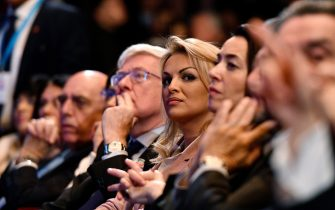 Francesca Pascale (C), the companion of the leader of the Italian right-wing party Forza Italia (Go Italy) Silvio Berlusconi, listens to Berlusconi speech as she sits in the audience during a campaign rally in Milan on February 25, 2018, ahead of the Italian general elections of next week.Silvio Berlusconi, the billionaire media mogul who dominated Italian politics for nearly two decades, has stepped back into the ring at the age of 81, defying those who dared to believe he had thrown in the towel. Despite sex scandals, serial gaffes and legal woes, the flamboyant tycoon has made an astonishing return from political oblivion to head his centre-right Forza Italia (Go Italy) party, which as part of a rightwing coalition is leading the race for the March 4, 2018 vote.   / AFP PHOTO / Piero CRUCIATTI        (Photo credit should read PIERO CRUCIATTI/AFP via Getty Images)