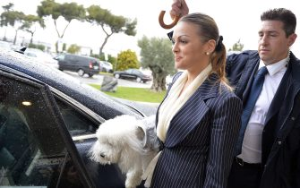 Francesca Pascale, the girlfriend of former Italian Prime Minister arrives at the Fiumicino Airport, near Rome on March 25, 2014.   Italy's former prime minister and media tycoon Silvio Berlusconi on March 22, 2014 dismissed rumours that one of his children would fly his party's colours in the European Union's May elections. AFP PHOTO / ANDREAS SOLARO        (Photo credit should read ANDREAS SOLARO/AFP via Getty Images)